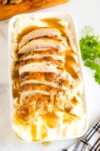 overhead picture of sliced turkey, gravy, and mashed potatoes.