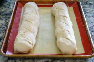 The rolled dough before it rises.