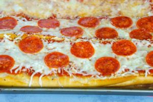 Top with cheese and reserved pepperoni and bake until the cheese is melted.