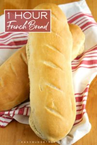 Finished loaves of bread with text overlay for Pinterest.