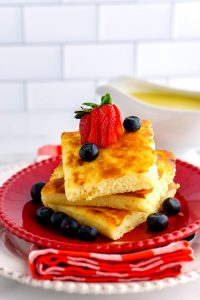 pancakes on a red plate.