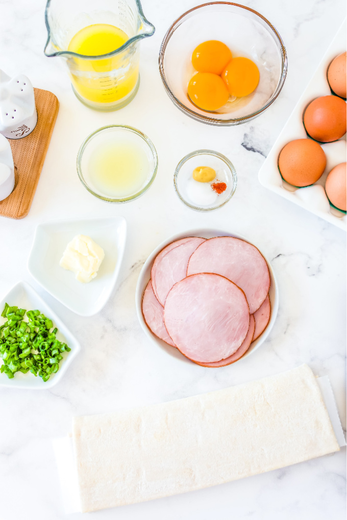 An overhead picture of all of the ingredients needed to make eggs Benedict braid.