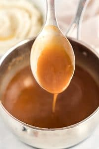Keep whisking and cooking until the gravy thickens.