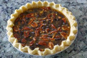 Pour the filling into the pie crust.