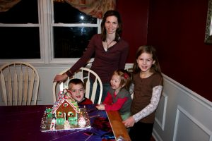 Beth with 3 of her kids making gingerbread houses.