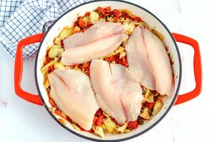 Place the tilapia onto of the tomatoes mixture, cover and cook for 8 minutes.