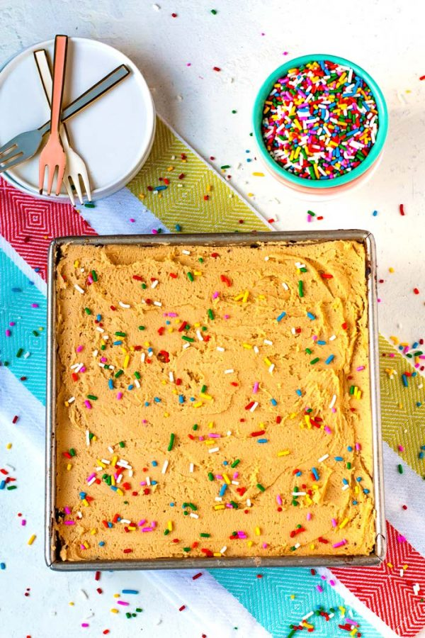 Overhead picture of a chocolate crazy cake with peanut butter frosting and sprinkles.