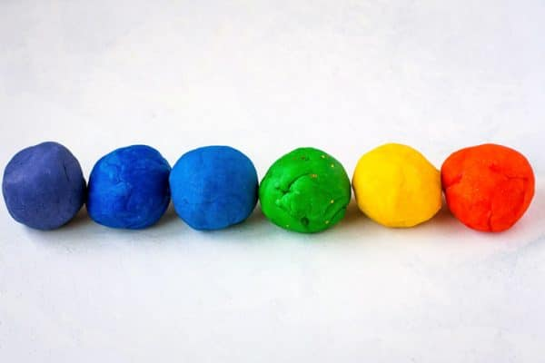Balls of playdough in a row.