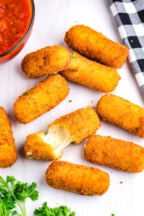 An overhead picture of the finished Mozzarella Cheese Sticks on a counter.