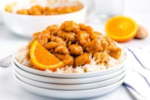 Serve the orange chicken over a bed of white rice or with chow mein.