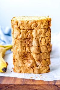 Slices of cake mix banana bread stacked on top of each other.