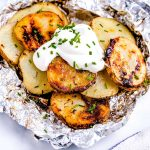 Close up picture of the finished grilled potatoes in foil.