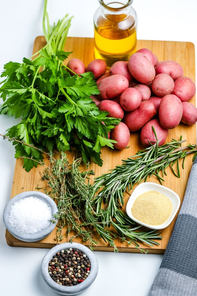 All of the ingredients needed to make oven roasted red potatoes.