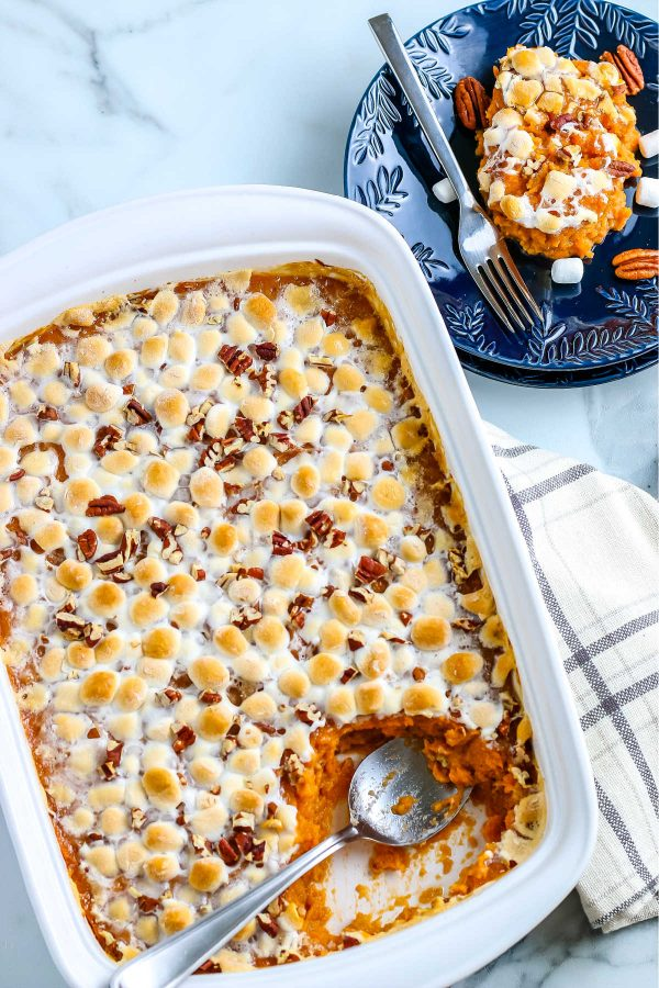 An overhead picture of sweet potato casserole with marshmallows and pecans.