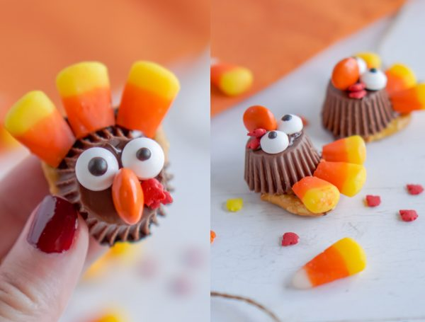A hand picking up turkey treats made with candy corn.