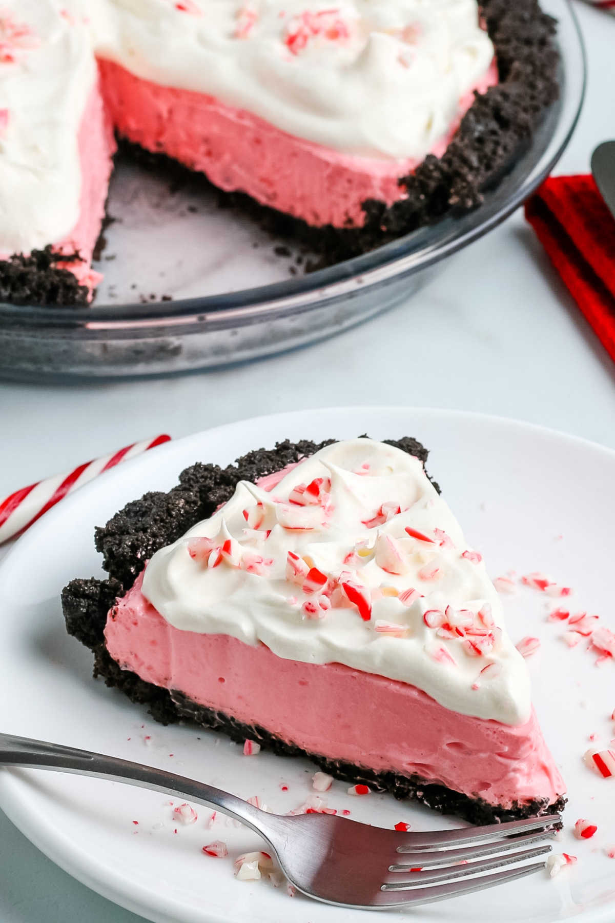This no-bake Peppermint Pie is festive and easy to make. Candy Cane Pie has a light and creamy texture that's brimming with peppermint flavor!  via @easybudgetrecipes