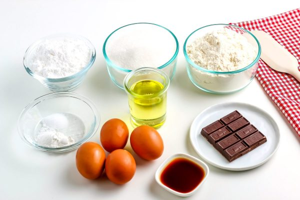 All of the ingredients needed to make chocolate crinkle cookies.