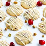 A close up picture of the finished Cranberry Cookies on a white surface.