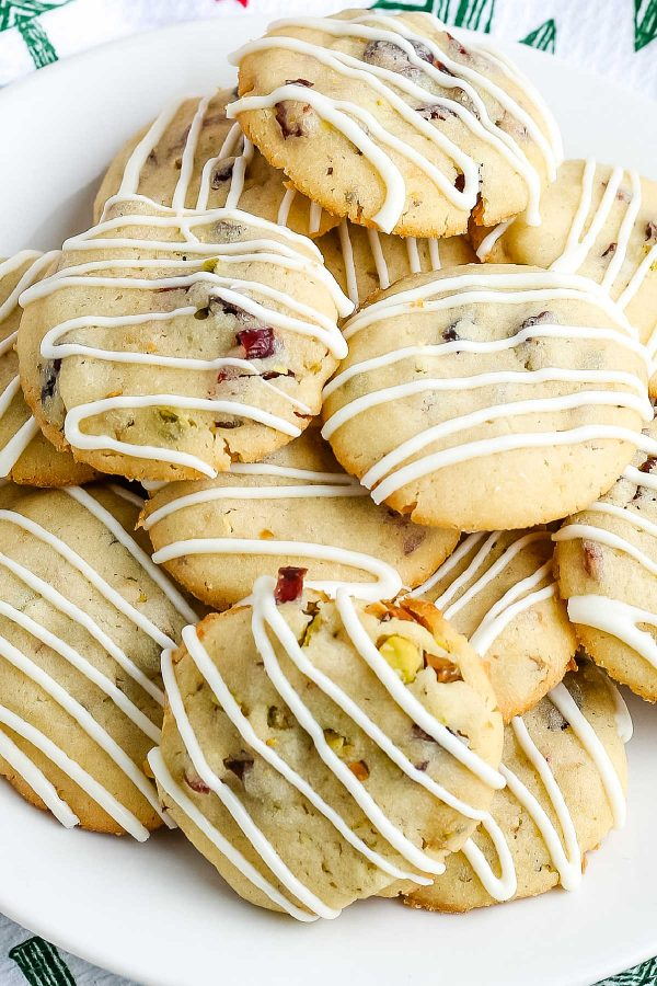 An overhead picture of cranberry pistachio cookies on a white plate.