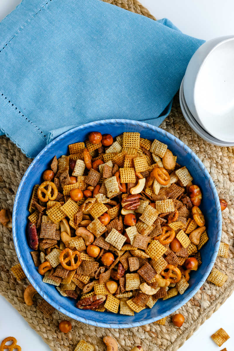 An overhead picture of the finished Chex Party Mix in a blue serving bowl.