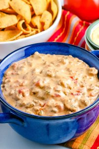 A close up of the finished Chile Con Queso in a blue bowl.