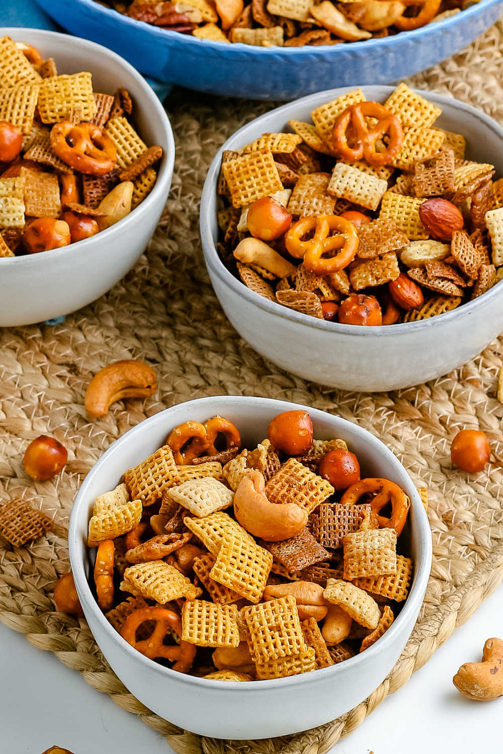 Chex Party Mix in three white bowls.