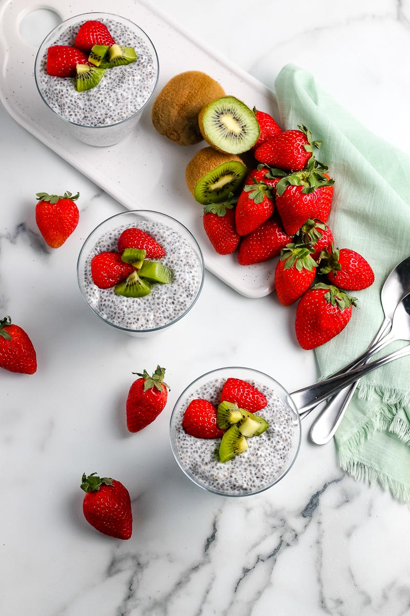 An overhead picture of the finished Chia Seed Pudding surrounded by strawberries and kiwi.