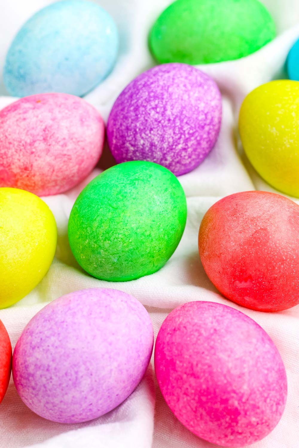 A close up picture of the finished food coloring dyed Easter eggs.